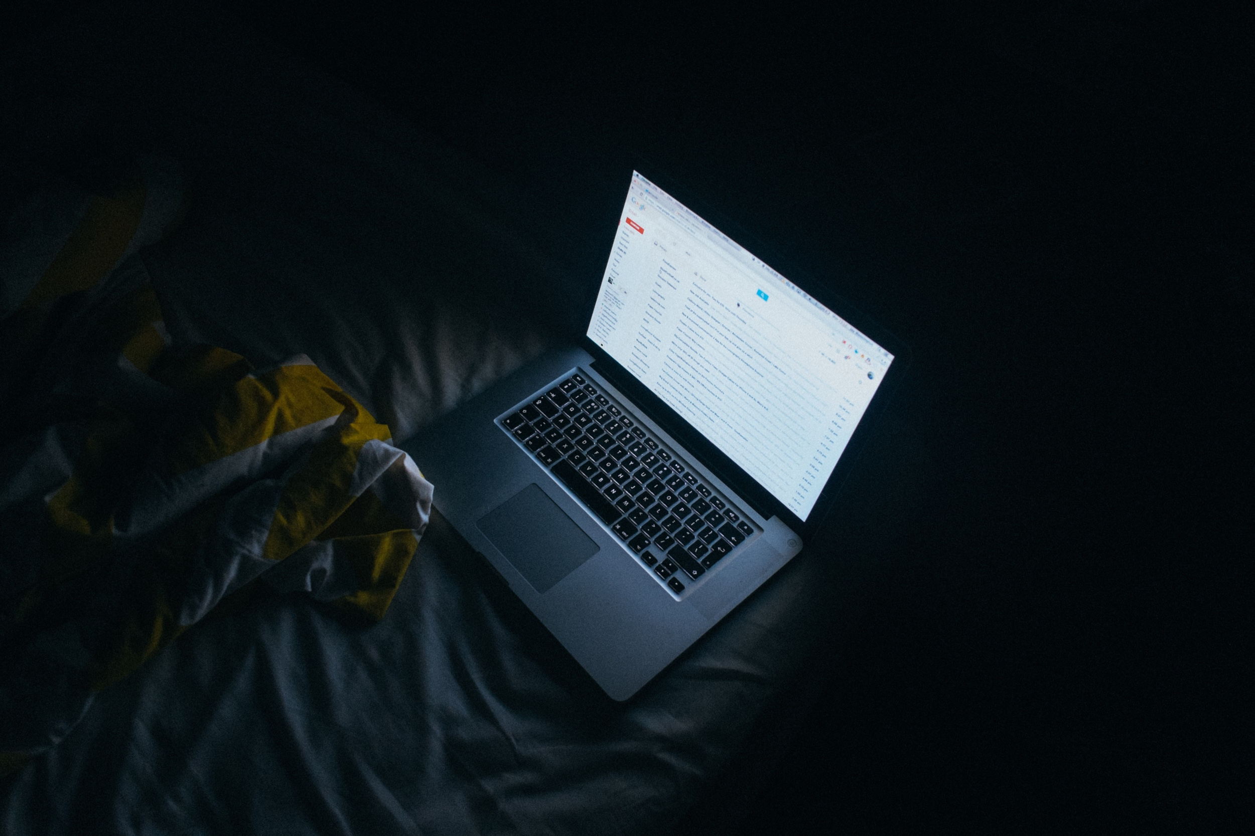 Laptop glare in a dark setting